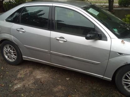 Sell well kept grey/silver 2004 Ford Focus sedan at price ₦400,000