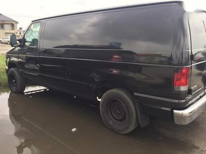 Best priced black 2013 Ford E-150 automatic
