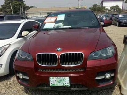 Red 2011 BMW X6 sedan automatic car at attractive price