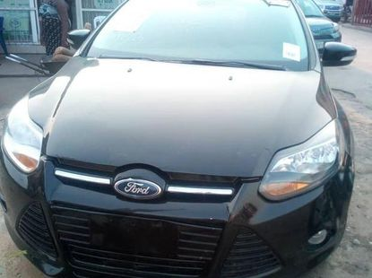 Sell black 2014 Ford Focus hatchback at mileage 62,000 in Lagos