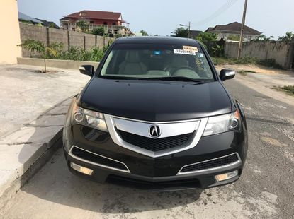 Selling black 2010 Acura MDX suv automatic in Lagos
