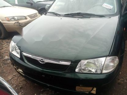 Sell authentic used 2002 Mazda 323 automatic