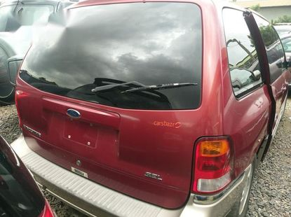 Sell cheap red 2002 Ford Windstar at mileage 100,000