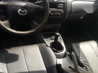 Used 2003 Mazda 323 car manual at attractive price in Abuja