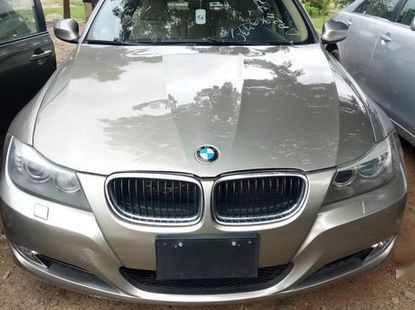 Gold 2009 BMW 328i automatic for sale in Abuja