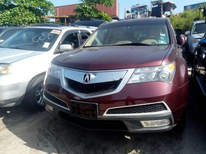 Foreign Used 2010 Maroon Acura MDX for sale in Lagos