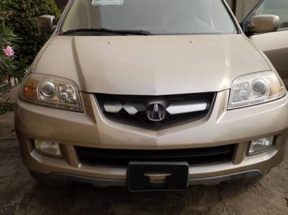 Foreign Used 2006 Gold Acura MDX for sale in Lagos