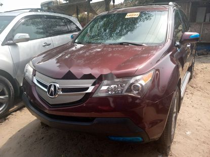 Foreign Used 2007 Maroon Acura MDX for sale in Lagos.