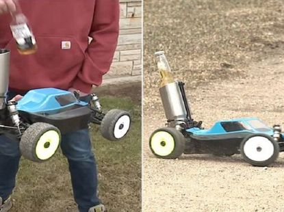 COVID-19: Neighbors practicing social distancing shares beer using remote-controlled car