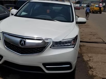 Foreign Used 2015 White Acura MDX for sale in Lagos.