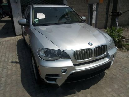 Foreign Used 2013 Silver BMW X5 for sale in Lagos.