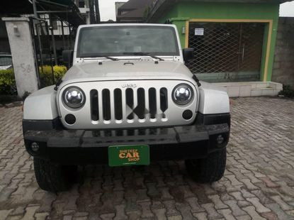 Foreign Used 2009 upgraded to 2016 Silver Jeep Wrangler for sale in Lagos.