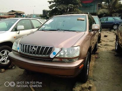 Foreign Used 2002 Brown Lexus RX for sale in Lagos