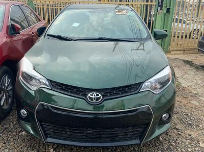 Foreign Used 2014 Green Toyota Corolla for sale in Oyo.