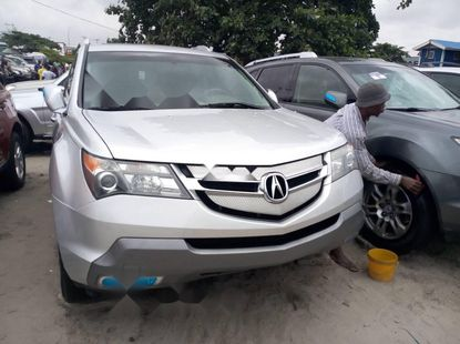 Foreign Used 2009 Silver Acura MDX for sale in Lagos