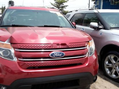 Foreign Used 2013 Red Ford Explorer for sale in Lagos.