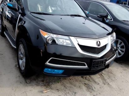 Foreign Used 2010 Black Acura MDX for sale in Lagos.