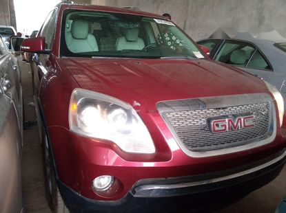 Foreign Used 2009 Red GMC Acadia for sale in Lagos.