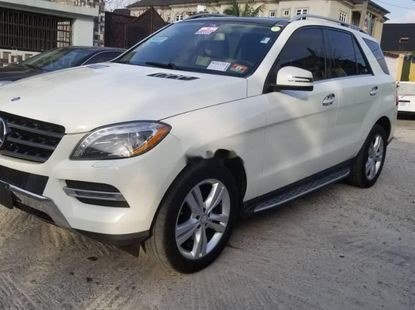 Foreign Used 2013 White Mercedes-Benz ML350 for sale in Lagos.