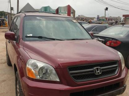 Foreign Used 2005 Red Honda Pilot for sale in Lagos.