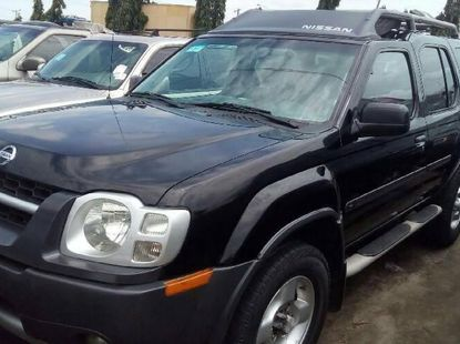 Foreign Used 2004 Black Nissan Xterra for sale in Lagos.