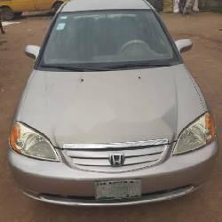 Naija Used 2002 Gold Honda Civic for sale in Lagos.