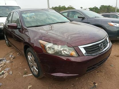 Foreign Used 2009 Maroon Honda Accord for sale in Abuja.