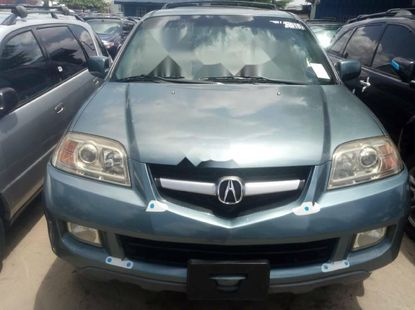 Foreign Used 2006 Blue Acura MDX for sale in Lagos.