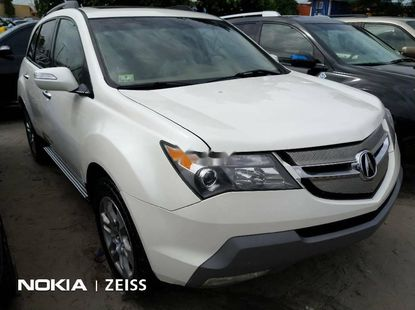 Foreign Used 2009 White Acura MDX for sale in Lagos.