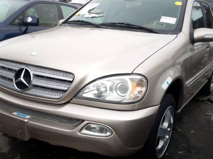 Foreign Used 2003 Gold Mercedes-Benz ML 320 for sale in Lagos.