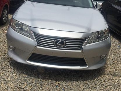 Foreign Used 2013 Silver Lexus ES for sale in Abuja.