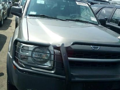 Very Clean Foreign Used Grey Nissan Xterra 2004 Model for sale in Lagos.