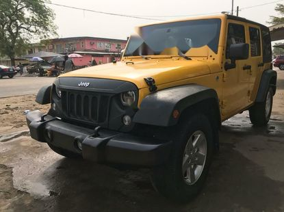 Foreign Used 2015 Yellow Jeep Wrangler for sale in Lagos.