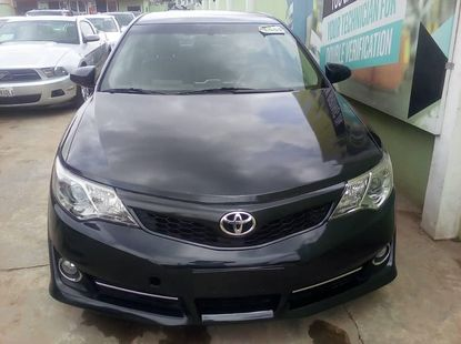 Foreign Used 2013 Black Toyota Camry for sale in Lagos.