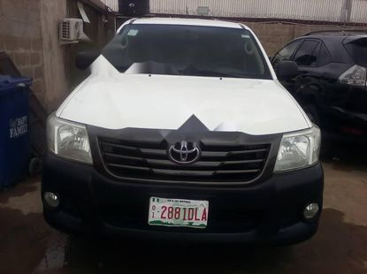 Foreign Used 2013 White Toyota Hilux for sale in Lagos.