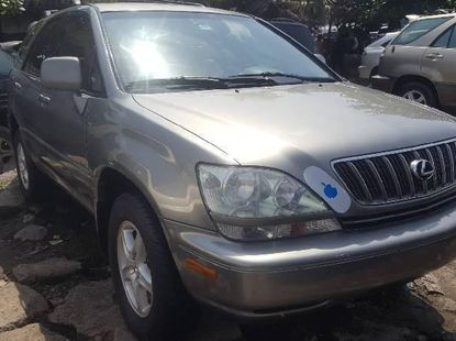 Foreign Used 2002 Gold Lexus RX for sale in Lagos.