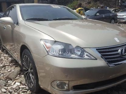 Foreign Used 2011 Gold Lexus ES for sale in Lagos.