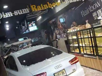 Fight over parking space gets out of control as Audi car crashes into bakery